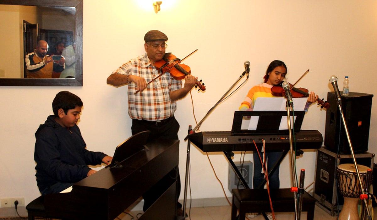Piano and violin at house concert